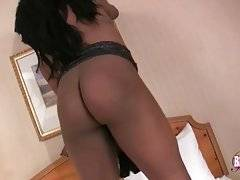 Chocolate She-Male Is Caressing Herself 3
